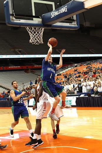 Cicero-North Syracuse guard Connor Evans (1) goes up for a shot in Saturday night's Section III Class A final at the Carrier Dome. Evans had 33 points, but the Northstars lost 83-79 to the Raiders.