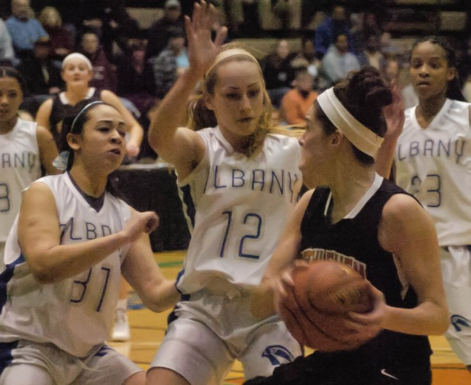 Bethlehem's Jenna Giacone, right, is met by two Albany defenders during Thursday's Section II Class AA semifinal at Hudson Valley Community College.