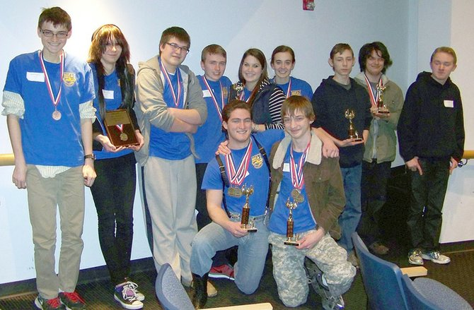The Cazenovia Academic Decathlon posed with their awards after winning the Section III title in January.