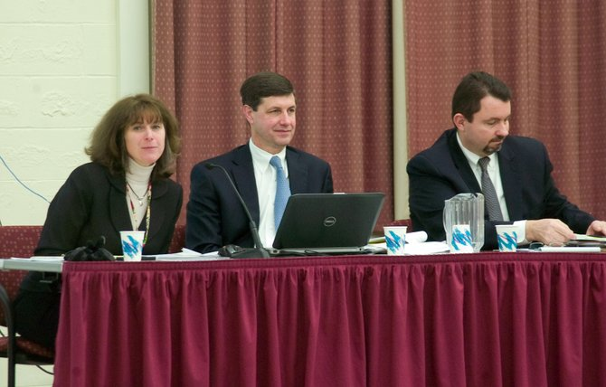 Guilderland School Superintendent Marie Wiles, Assistant Superintendent Neil Sanders and Assistant Superintendent for Instruction Demian Singleton listen to comments from community members after Wiles presented her proposed 2014-15 budget Thursday, Feb. 27.