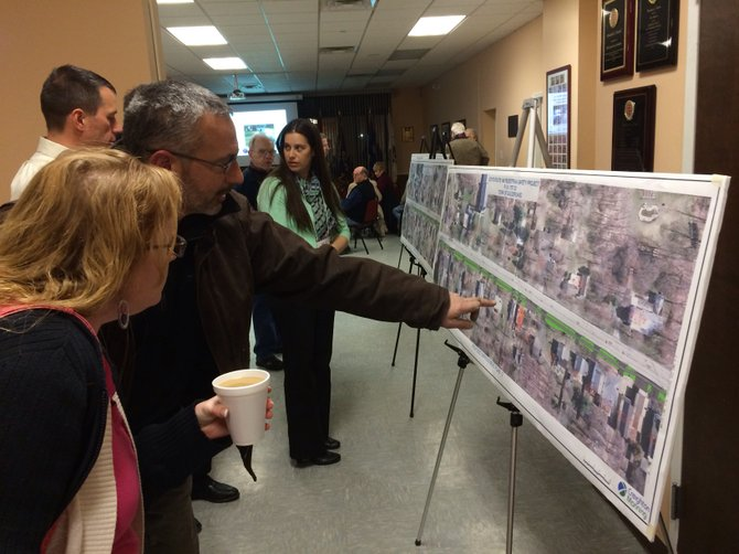 Guilderland Center residents view a satellite image outlining where a proposed pathway would be installed through the hamlet. The paved walkway would run through a portion of the hamlet along Main Street.