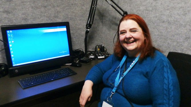 READ-OUT coordinator Mary Lamb sits in the recording studio at WCNY-FM, where volunteers serve the blind and visually-impaired by reading various publications for radio broadcast.