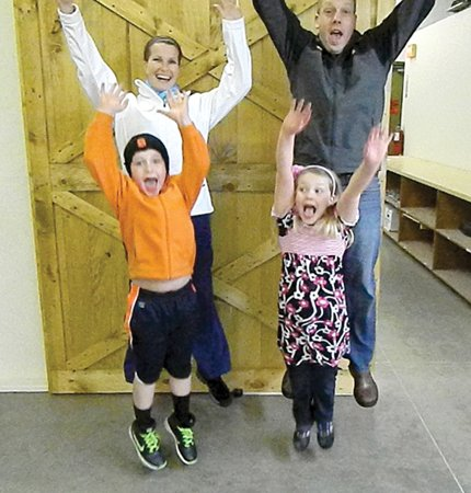 The Reilley family jumps in excitement inside their new production facility in Trush Business Park in Nelson.