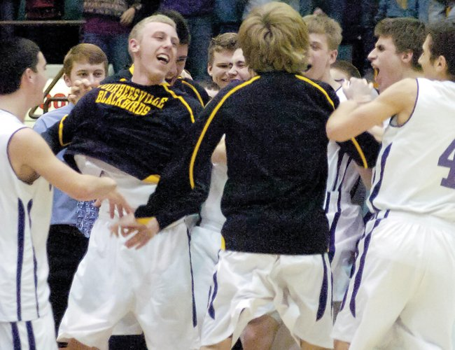 The Voorheesville boys basketball team celebrates its Section II Class B championship game victory over Broadalbin-Perth March 1.
