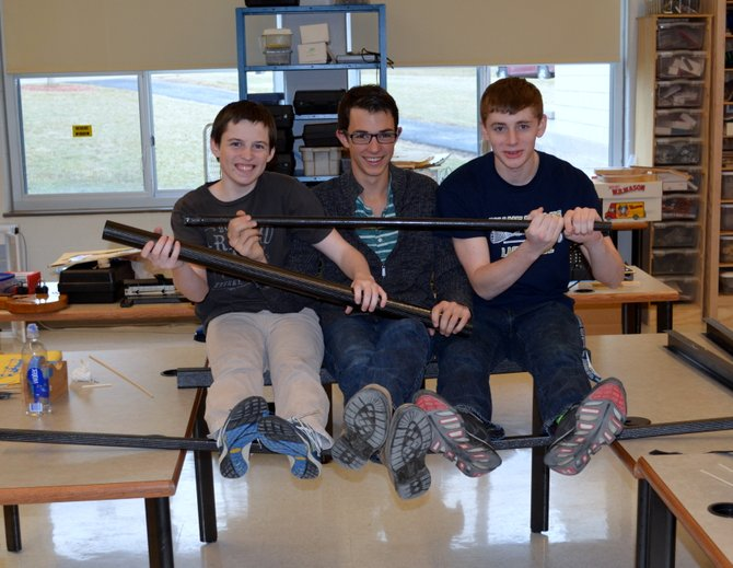 From left:  Juniors Dalton Carter, Joe Buck and Brett Singler check out the light weight carbon fiber tubes used in their engineering classes to make high strength structures and test engineering concepts.