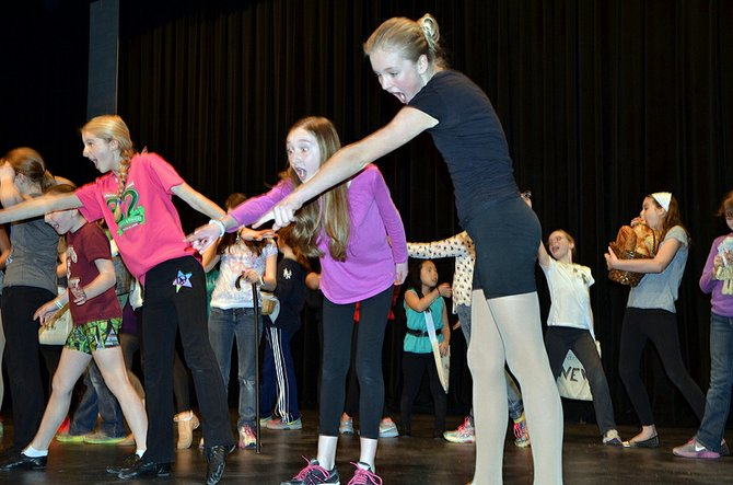 "Students rehearse the middle school musical ""Over the Moon."""