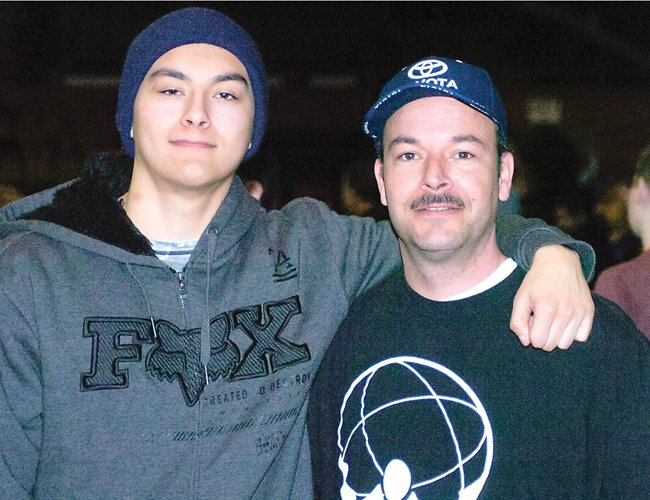 Darby Wilson Jr., left, and his father, Darby Wilson Sr., travel throughout the Northeast and Mid-Atlantic so Wilson Jr. can compete at North American Grappling Association events.