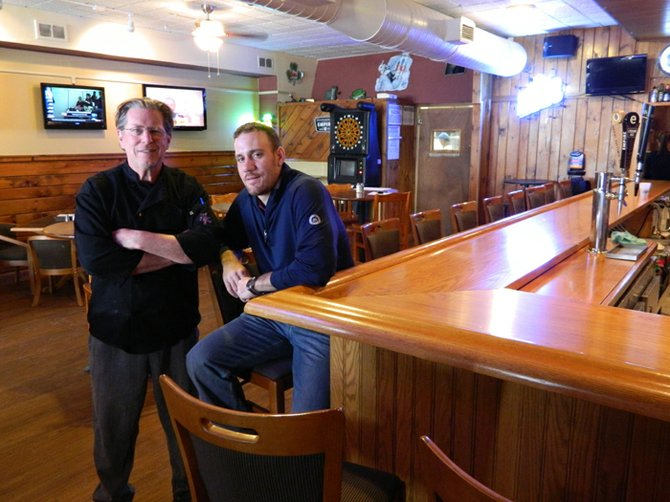 Geoff Zimmer, right, owner of the new Junior's Caz Bar at 64 Albany St., and Brian Dufe, left, head chef, are running Cazenovia's newest food and drink location — a place that serves lunch and dinner seven days a week with high quality food, a fully stocked bar with multiple televisions at which to relax and an overall family-friendly atmosphere.