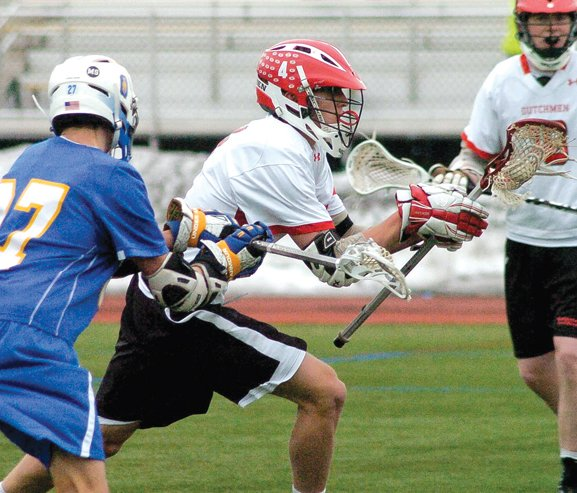 Guilderland's Jake Smith charges past a Queensbury defender during Saturday's non-league season opener at Skidmore College in Saratoga Springs.