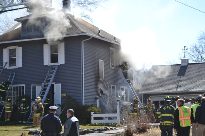 Firefighters battle a blaze at a home at 6 Adams St. in Delmar Thursday, April 3.
