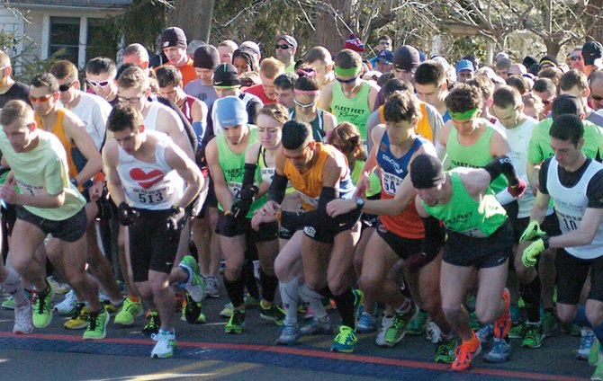 Runners take off from the starting line at the 2014 Delmar Dash Sunday, April 6.