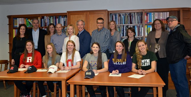 Skaneateles athletes, pictured with their parents, after signing letters of intent to play at the collegiate level at an event held at the high school on Friday. From left: Alana Navaroli, Rutgers University for lacrosse; Casey Van Slyke, Johns Hopkins University for lacrosse; Molly Wood, Ohio State University for lacrosse; Malorie Olin, Rollins College for lacrosse; Kristen Pille, Nazareth College for lacrosse and Joanna Dobrovosky, LeMoyne College for basketball. Not pictured is Nicole Beatson, who will play lacrosse in college, but has yet to decide where.