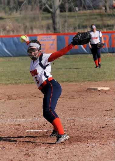 Liverpool senior pitcher Dana Nicoletti (8) stares down at the plate as she winds up and throws in last Thursday's season-opening 18-2 win over Auburn. Splitting pitching duties with Peyton Bellrose, Nicoletti helped the Warriors to a 3-0 start.