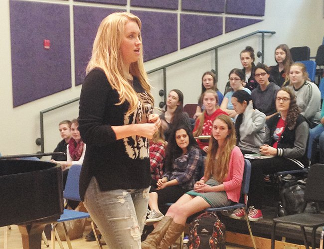 Danielle Mozeleski, also known as Dani Moz on The Voice, talks to students at Bethlehem High School, on Wednesday, April 9.