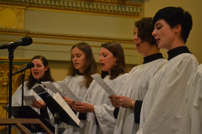 Five members of the St. Matthew's choir sing the Hosanna during the 11 a.m. Palm Sunday Mass on April 13.