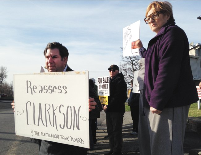 About 30 landowners of large property in the Town of Bethlehem staged a protest on Thursday, April 17, outside of Milestone Restaurant in Glenmont where town Democrats were holding their annual fundraiser.