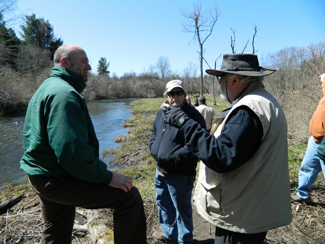 DEC Region 7 Fisheries Manager Dave Lemon, left, listens as Trout Unlimited Chapter 680 members Lee Cameron, middle, and Jim Longstaff talk about fishing on Chittenango Creek. The three men attended the April 24 grand opening event for the new public access fishing site along Chittenango Creek on Route 13 in the town of Cazenovia.