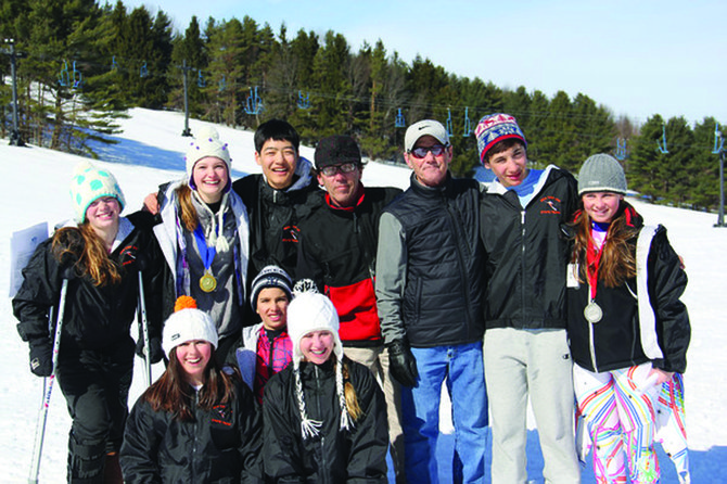 SKI STARS: The Toggenburg Junior Ski Racing team had a successful winter season, reaching various state, regional and national championship round. Front row, from left: Morgan Gregg (Cazenovia), Addison Wallace (Fabius-Pompey), Grace Weiseger (Fayetteville-Manlius). Back row: Bridie Larkin (F-P) Paige Petrell (Jamesville-DeWitt) Justin Kim (F-M) coach Dave Hoyt, coach  Bruce Wilkie, Eli Weiss (Manlius-Pebble Hill), Sarah Buck (F-M).