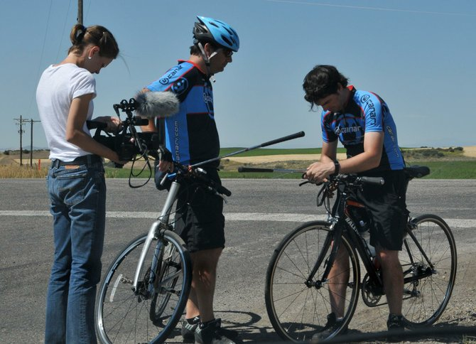 "From left: Julia Wrona films Pete and Pearson Constantino during their cross-county bike ride shown in the film ""The Long Bike Back."" The Constantinos are originally from Skaneateles and the film features several scenes filmed locally since they rode Route 20 and took a break in Skaneateles."