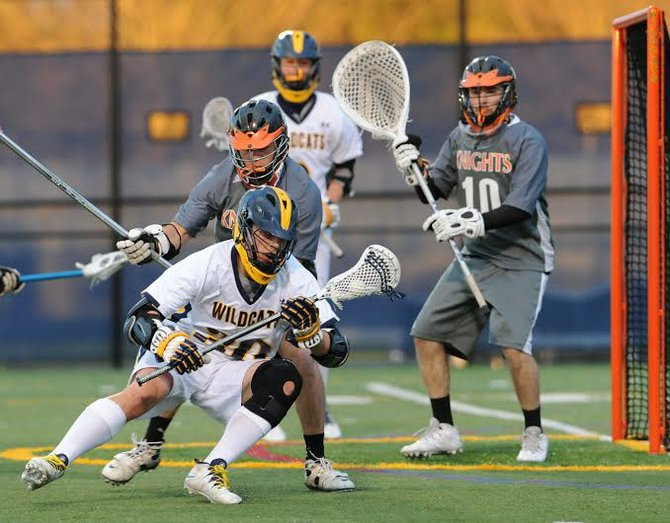 West Genesee attacker Will Northrop (30) goes near the turf to protect the ball from Rome Free Academy defender Brian Stapleton in Thursday night's game. Northrop scored three times in the Wildcats' 16-3 victory over the Black Knights.