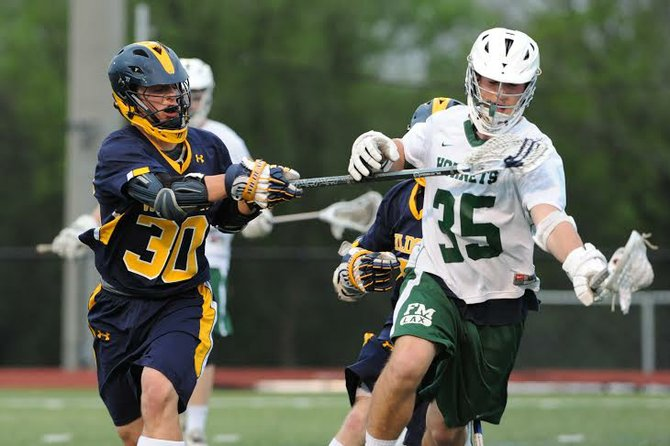 Fayetteville-Manlius defender Gabe Neils (35) takes the ball out of his own end, pressured by West Genesee's Will Northrop, in Monday night's game. Neils and the Hornets' defense blanked the Wildcats in the fourth quarter, keying a 9-6 victory.