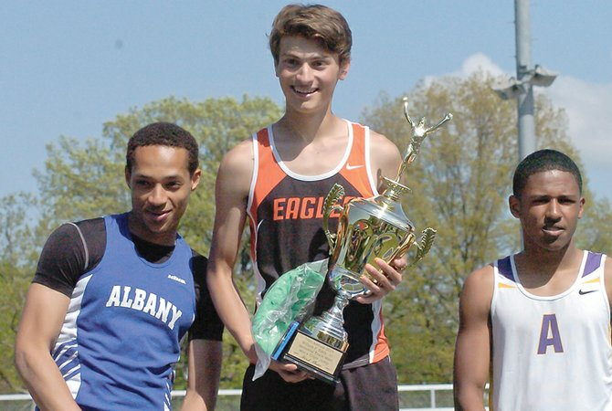 Bethlehem's Brian Greenberg, center, holds his triple jump championship trophy at the Eddy Meet Saturday, May 17, at Schenectady High School.