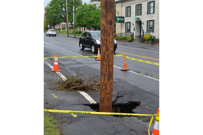A sinkhole formed Thursday morning, May 22, around a utility pole on Delaware Avenue in Delmar.