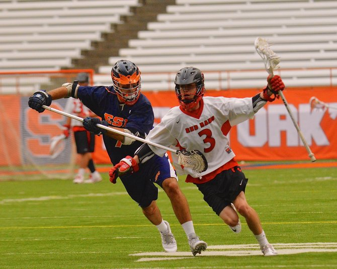 Jamesville-DeWitt midfielder Griffin Johnson (3), defended by East Syracuse-Minoa's Nick Sturick (7) in Saturday's Section III Class B final at the Carrier Dome, amassed seven assists to go with two goals in the Red Rams' 23-13 victory over the Spartans.