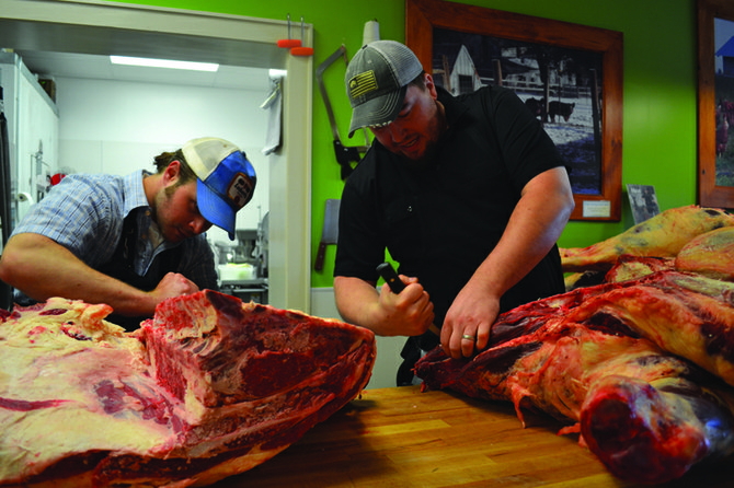 "Butcher assistant Dan Putnam and head butcher Kevin McCann cut into some freshly-delivered beef at Side Hill Farmers in Manlius, which is expanding this summer. ""We probably can get eight or nine steaks out of here, maybe some brisket and short ribs too – lots of different items. It's somewhat time consuming and pretty intricate,"" McCann said."