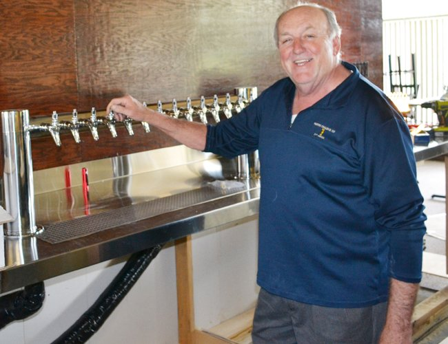 Roger Martel, owner of Martel's Restaurant, stands in the new bar at the clubhouse at the Town of Colonie Golf Course.