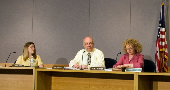 Guilderland Zoning Board of Appeals Chairman Thomas Remmert, center, on Wednesday, May 21, outlines proposed conditions for Dale Owen to keep chickens outside his home. The resolution failed.