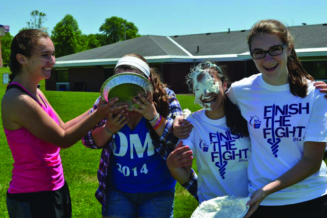"Members of the Fayetteville-Manlius High School student council ""pie"" two of this year's Dance Marathon MCs to raise money for F-M Relay for Life."