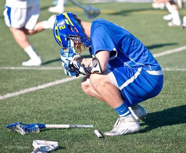 Cazenovia senior midfielder Henry Mann (2) reflects the disappointment of the Cazenovia boys lacrosse team as it lost, 13-10, to Bronxville in Saturday's state Class C final at Hofstra University. The Lakers just missed earning its third state title in the last four years.