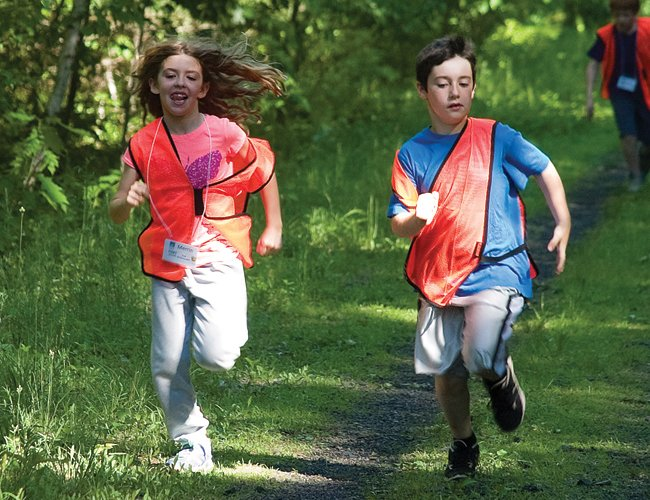 From left, Merrin and Tyler take a brief break from their Rail Trail ambassador duties to have race on Thursday, June 5.