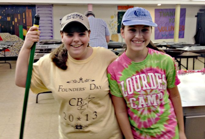 Wellwood Middle School students Julia Hamilton, eighth-grade, and Maurita Jeffery, seventh-grade, spent time volunteering at the Samaritan Center.