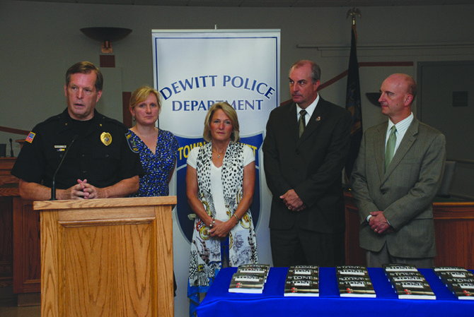 Pictured are DeWitt Police Chief Gene Conway, Mary Panek, J-D High School librarian, Marianne Angelillo, Chris Bednarski, from the District Attorney's office and Paul Gasparini, J-D High School principal.