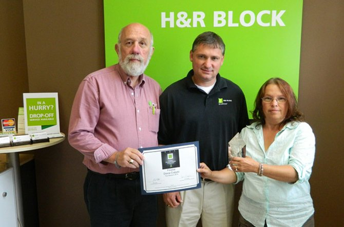 """H&R Block Franchise District Manager Todd Bernhardt, middle, traveled to Cazenovia on July 8 to present the award for the Cazenovia franchise being named as one of the top 100 H.R. Block franchises out of the 4,500 in the U.S. Accepting the award were Rick Hannfan, left, and Diana Cuipylo Carpenter, right. """"I was surprised,"""" Carpenter said of the award. """"I was thrilled, but not expecting it at all."""""""