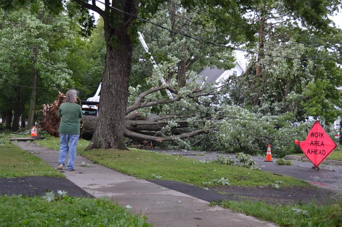The July 8 storm brought down trees and power lines, leaving nearly the entire village of East Syracuse without power.