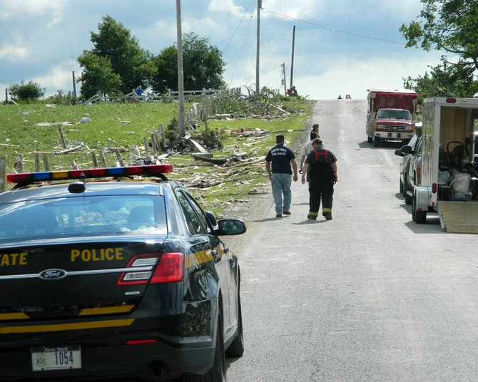 "The scene on Goff Road in Smithfield where two homes were completely destroyed looked like ""a bomb went off in a house"" as Gov. Andrew Cuomo said after touring the scene Wednesday morning. ""I thought I was in Kansas ... I just couldn't believe it,"" said Madison County Sheriff Allen Riley."