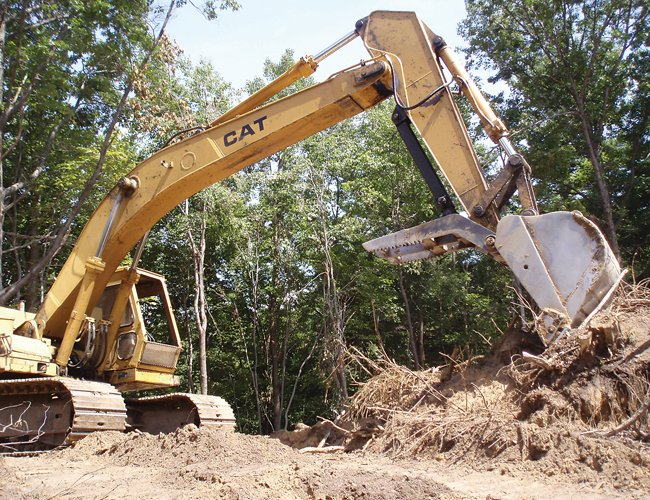 A bulldozer smooths out a section of the Great Dune after some black locust trees were removed from the Pine Bush Preserve.