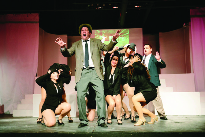 "Steve Gamba portrays FBI Agent Carl Hanratty, here singing ""Don't Break the Rules"" with the ensemble, in ""Catch Me If You Can"" running through Aug. 2, at CNY Playhouse, in DeWitt's ShoppingTown Mall."
