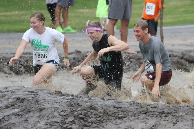"The water pit (pictured) is one of more than 20 obstacles in the ""Muddy Hornet Challenge,"" which is part of the third annual Fay-Man Day of Races.  The F-M Booster Club fundraiser also includes a 5k run and the ""Muddy Puppy Dash"" for kids."