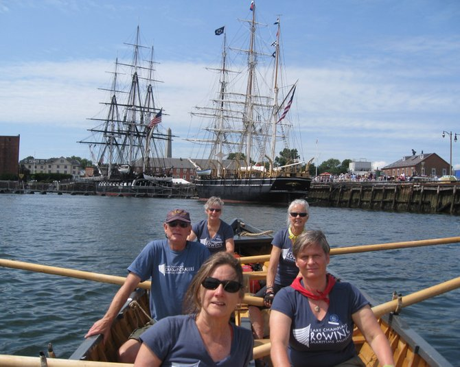 Members of the LCMM's Community Rowing Club in Boston Harbor last week.