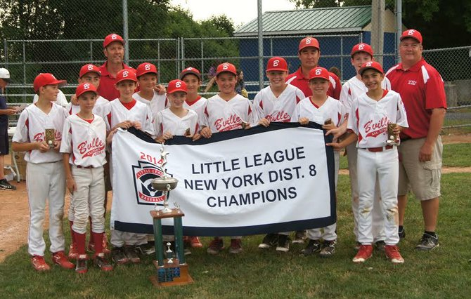 The Baldwinsville Little League Majors team won the District 8 championship and outscored opponents 103-21 during its post-season run. Front row, from left: Jason Savacool, Lucas Robinson, Patrick May, Bo Nicholson, Nick Chase, Michael Carr, Trey Blasi, Nate Ray, Derek Jann, Anthony Petragnani, Jeb Farneth, Whip Carni. Back row: manager Dan Robinson, assistant coach Randy Ray, assistant coach Chris Savacool.