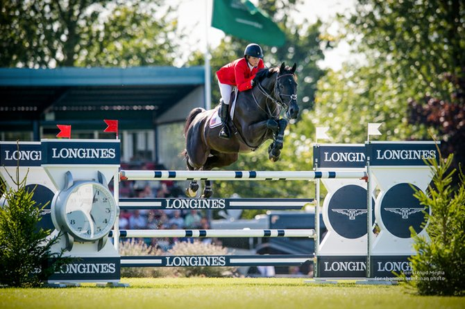 Beezie Madden and Cortes 'C' competing at the Longines Royal International Horse Show.