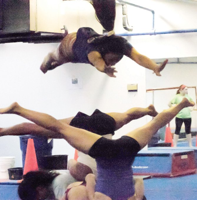 World Class Gymnastics Academy's adult class practices for its first exhibition show, which takes place Sunday, Aug. 24, at 1 p.m. The exhibition is a fundraiser for STRIDE Adaptive Sports.