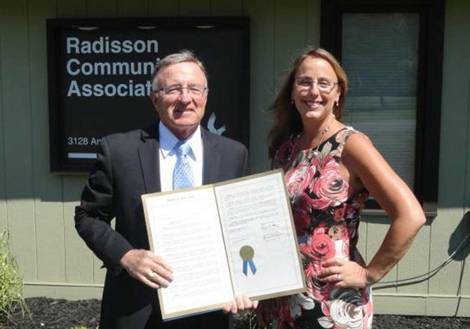 A State of New York Legislative Resolution, sponsored jointly by Senator DeFrancisco and Assemblyman Barclay, recognizing the 40th Anniversary of the Radisson Community Association and a Resolution from the Onondaga County Legislature, sponsored by Legislator Brian May, honoring the Radisson Community for its 40th Anniversary.