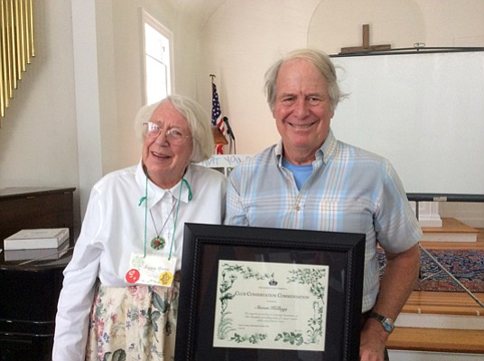 Pictured here, Happy Marsh presents author and Illustrator Steven Kellogg with Essex County Garden Club's GCA Commendation at the Club's recent meeting held in Keene.