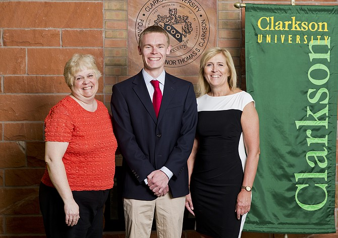 Award-winning VUHS teacher Roberta Steponaitis and senior student Nathan North of Vergennes (center), who nominated her for the Clarkson University honor. University Vice President Kathryn B. Johnson is pictured right.