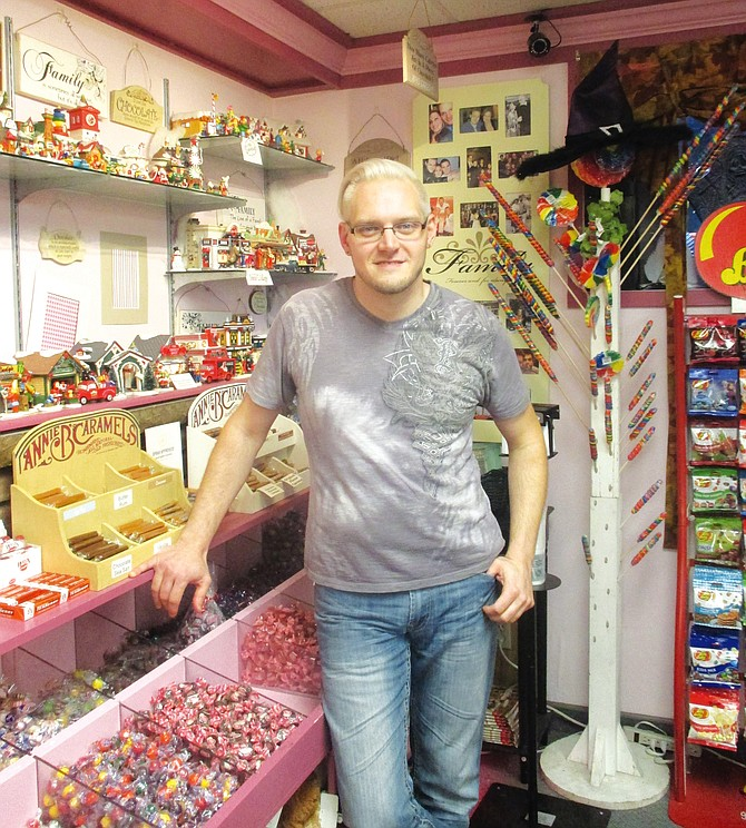 Michael Speach stands among his wares at Speach Family Candy Shoppe, which is celebrating its 95th anniversary Nov. 6 and 7. Speach's great-grandfather, born in Italy as Michele Spicciati, founded the M. Speach Candy Company in 1920.